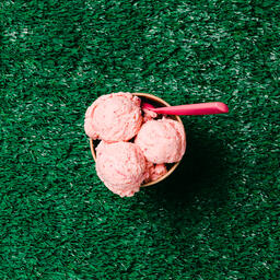 Carton of Strawberry Ice Cream with a Spoon on Grass  image 7