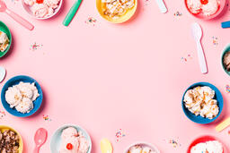 Bowls of Ice Cream and Spoons on Pink Background  image 1
