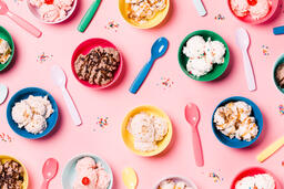 Bowls of Ice Cream and Spoons on Pink Background  image 5