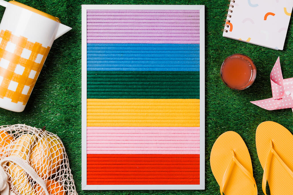 Letter Board with Summer Supplies on Grass large preview