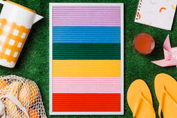 Letter Board with Summer Supplies on Grass  image 1