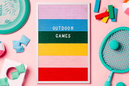 Outdoor Games Letter Board with Game Supplies on Pink Background  image 4