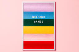 Outdoor Games Letter Board with Game Supplies on Pink Background  image 2