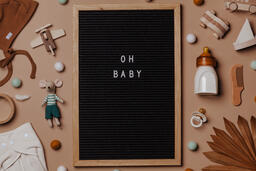 Welcome Baby Letter Board Surrounded by Baby Items  image 6