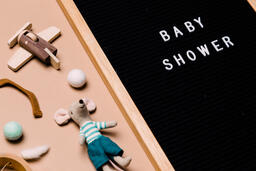 Baby Shower Letter Board Surrounded by Baby Items  image 2