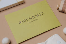 Yellow Baby Shower Invitation Surrounded by Baby Items  image 7