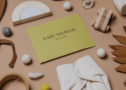 Yellow Baby Shower Invitation Surrounded by Baby Items  image 6