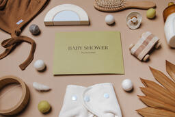Yellow Baby Shower Invitation Surrounded by Baby Items  image 9