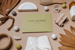 Yellow Baby Shower Invitation Surrounded by Baby Items  image 8