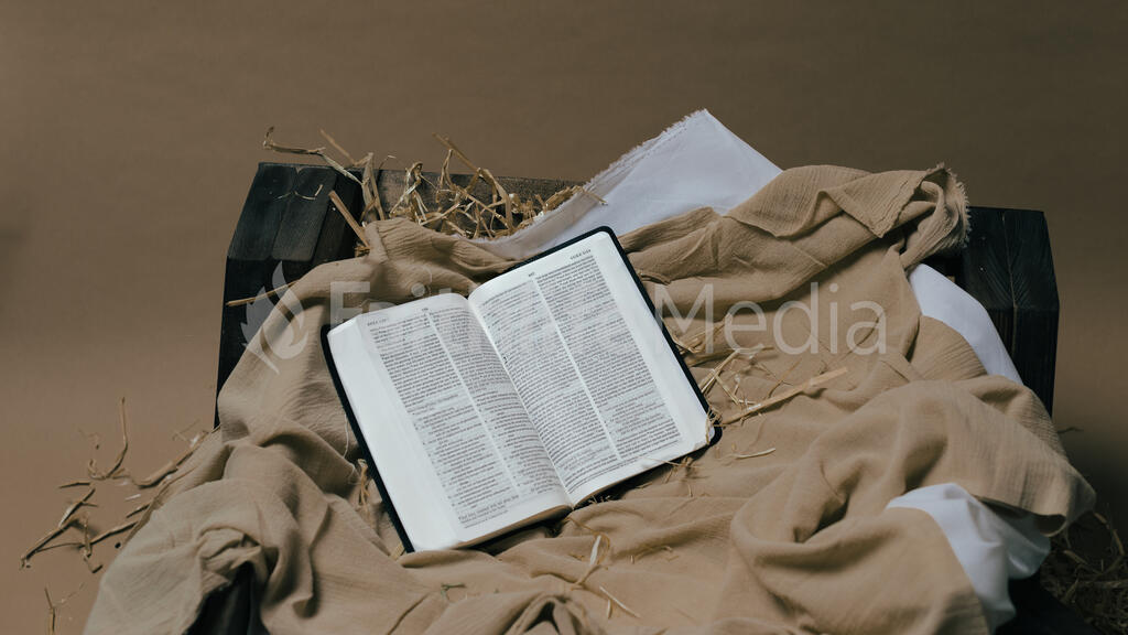 Bible Open to the Christmas Story in a Manger large preview