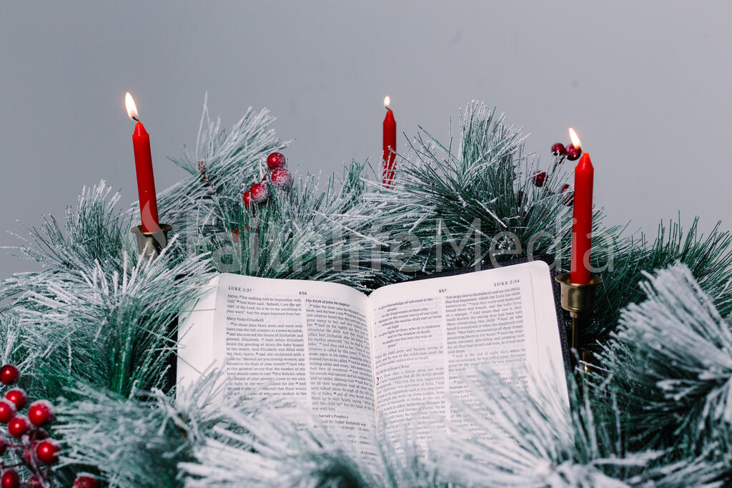 Bible Open to the Christmas Story with Greenery and Candles large preview