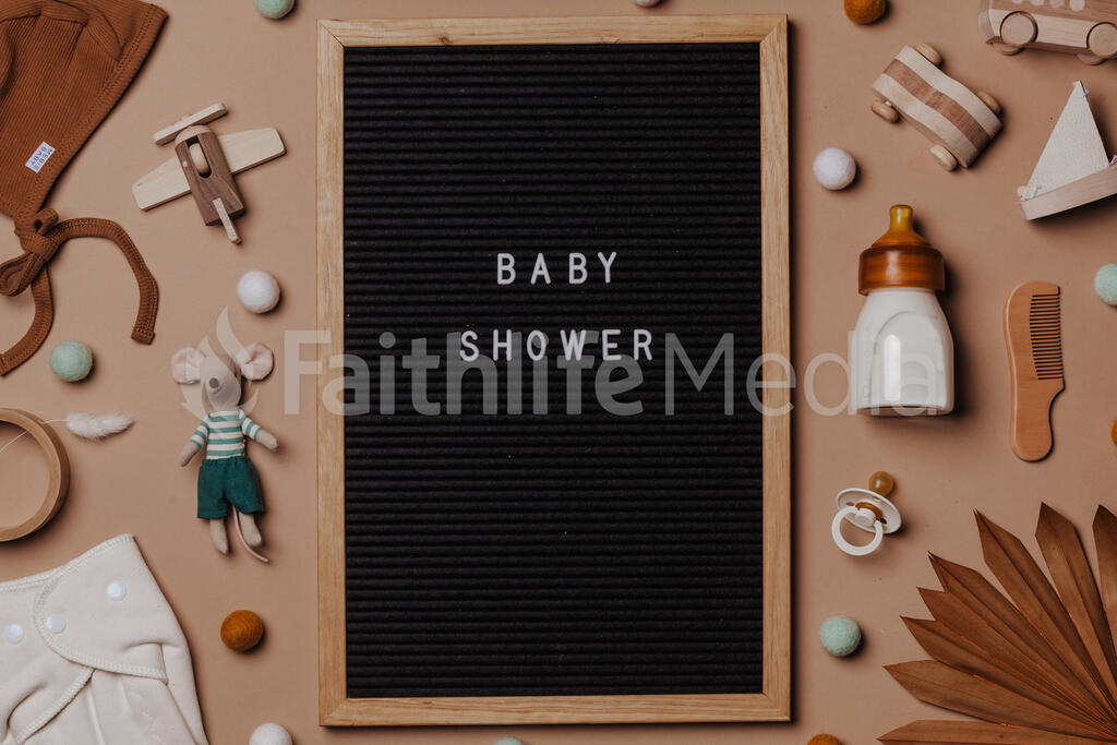 Welcome Baby Letter Board Surrounded by Baby Items large preview