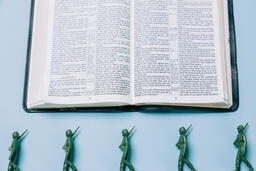 Open Bible with Toy Soldiers  image 2