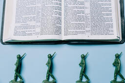 Open Bible with Toy Soldiers  image 5