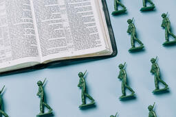 Open Bible with Toy Soldiers  image 4