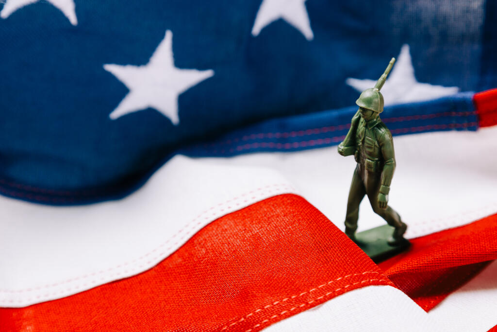 Toy Soldier Marching on an American Flag large preview