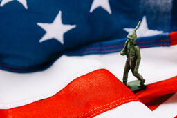 Toy Soldier Marching on an American Flag  image 1