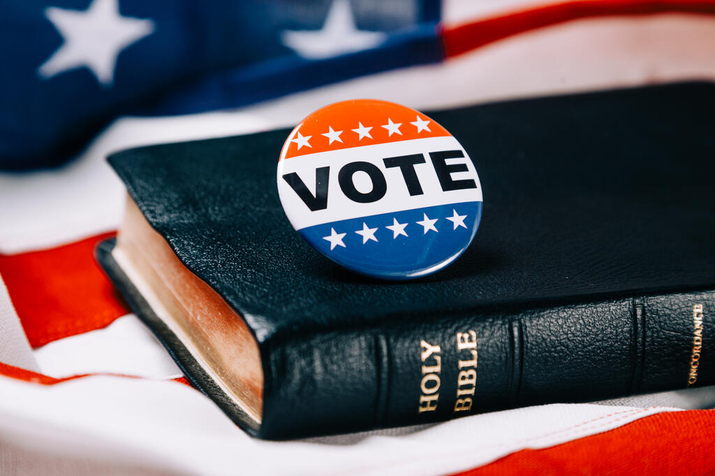 Vote Pin on the Bible with an American Flag large preview