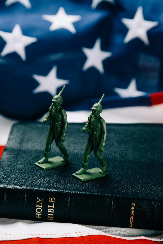 Toy Soldiers Marching on the Bible with an American Flag large preview