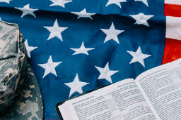 Military Hat and Open Bible on an American Flag  image 6