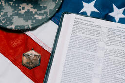 Military Hat and Open Bible on an American Flag  image 5