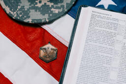 Military Hat and Open Bible on an American Flag  image 4