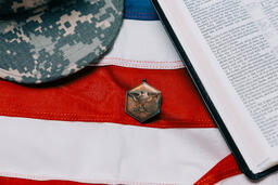 Military Hat and Open Bible on an American Flag  image 2
