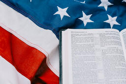Open Bible on an American Flag  image 1