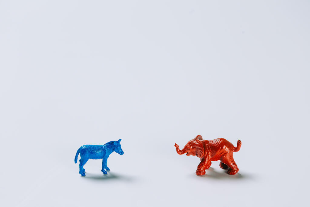 Blue Donkey and Red Elephant Facing Each Other large preview
