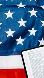 Open Bible on the American Flag  image 2