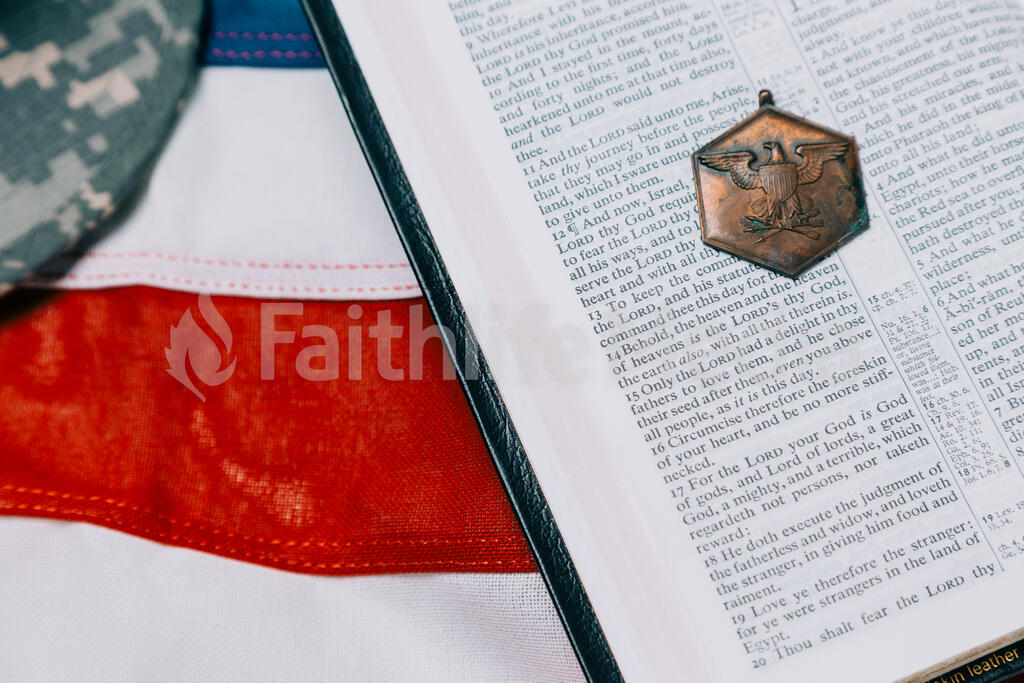 Open Bible with a Military Medallion on an American Flag large preview