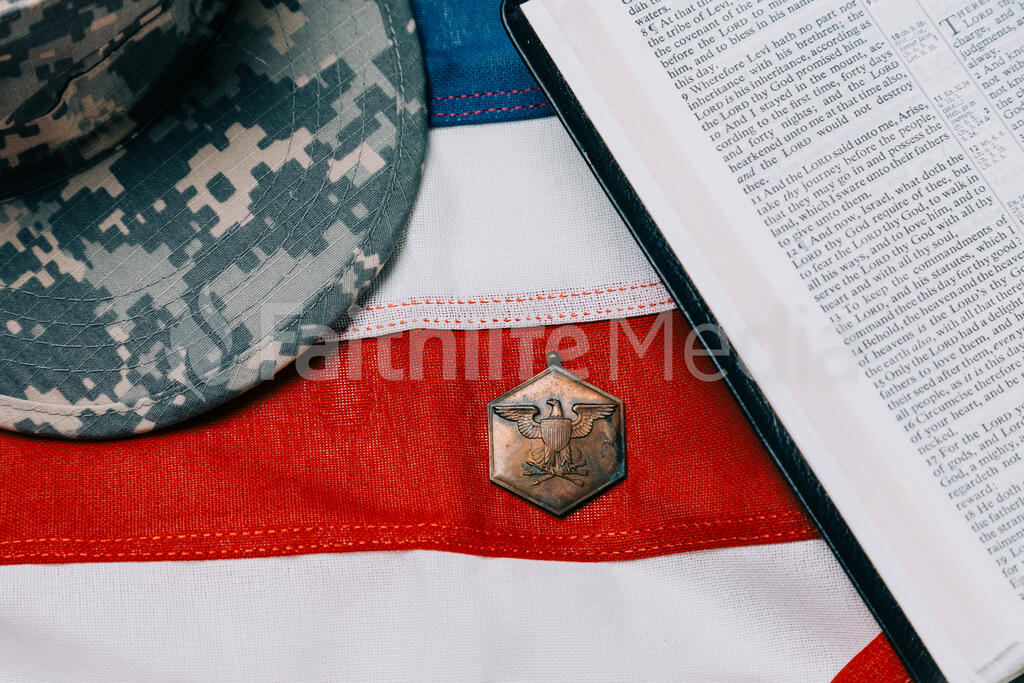 Military Hat and Open Bible on an American Flag large preview