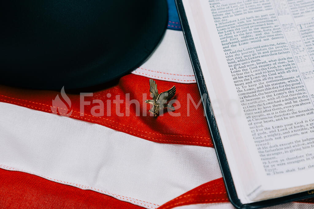Military Helmet and Open Bible on an American Flag with a Military Medallion large preview