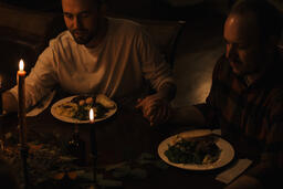 Small Group Praying Together Before a Meal  image 1