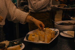 Woman Grabbing  a Piece of Bread with a Joy Tattoo  image 3