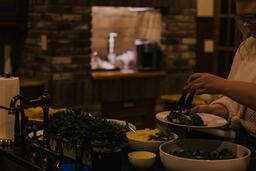 Woman Serving Up Salad  image 2