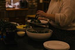 Woman Serving Up Salad  image 1