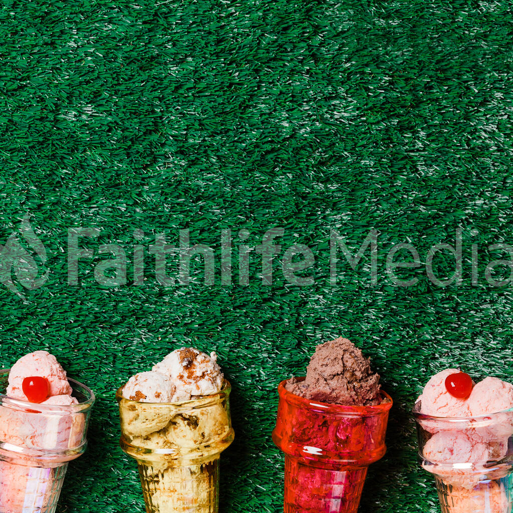 Ice Cream in Colorful Cone Dishes on Grass large preview