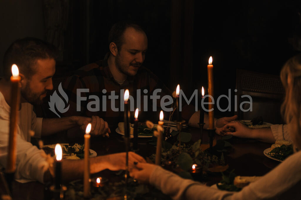 Small Group Praying Together Before a Meal large preview