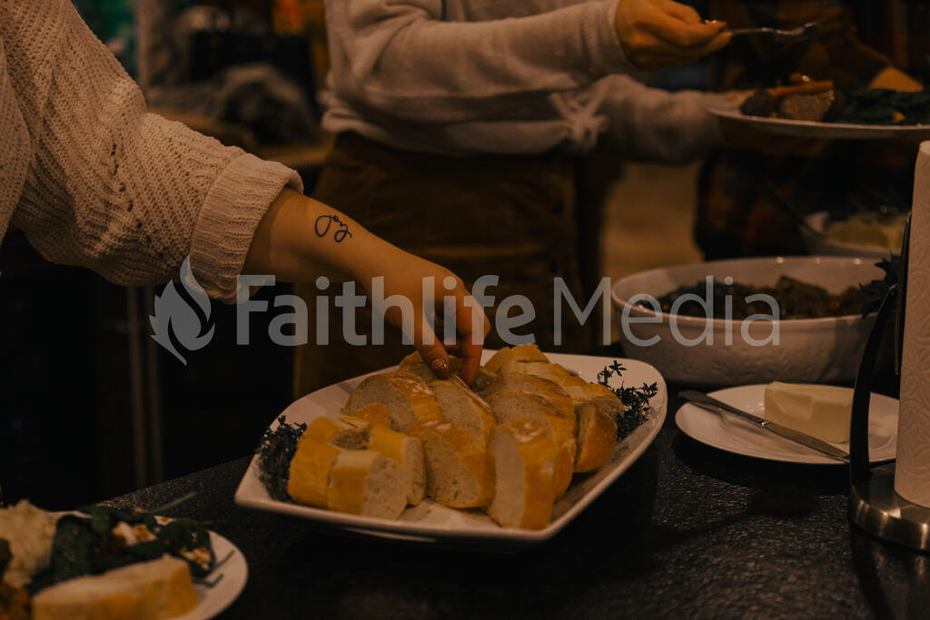 Woman Grabbing  a Piece of Bread with a Joy Tattoo large preview