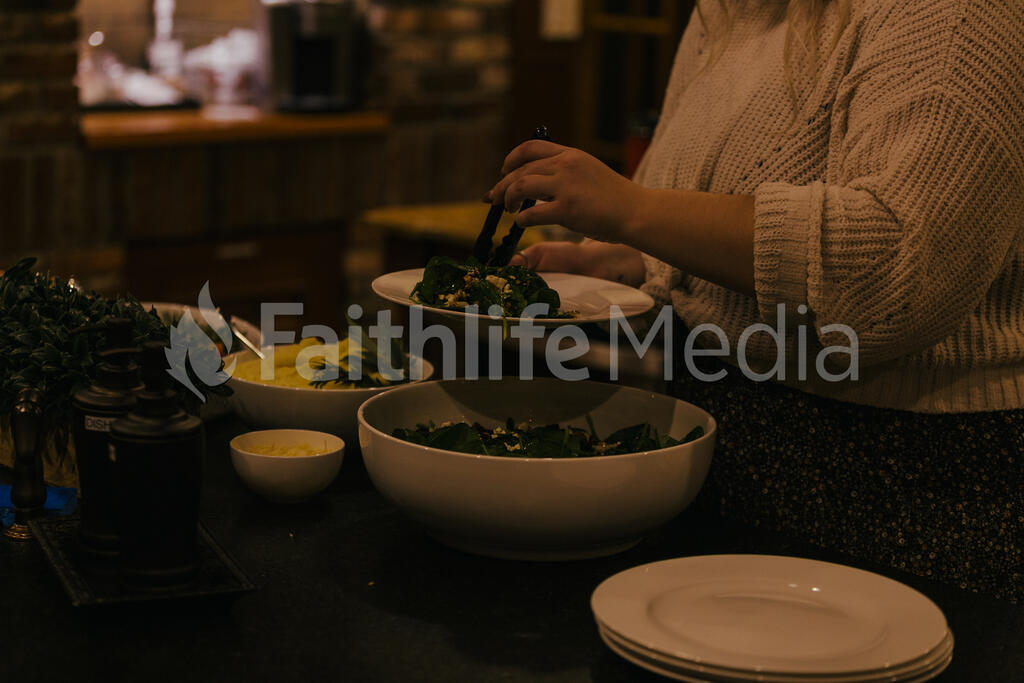 Woman Serving Up Salad large preview