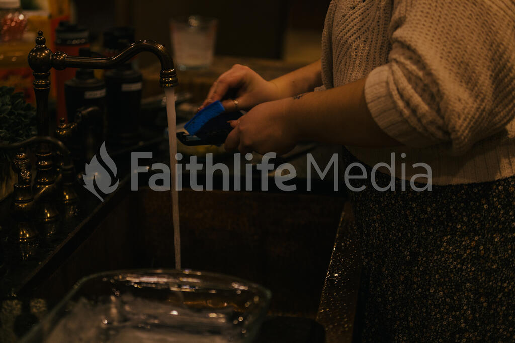 Woman Washing Dishes large preview