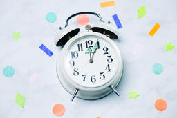 Clock Striking Midnight with Confetti  image 1