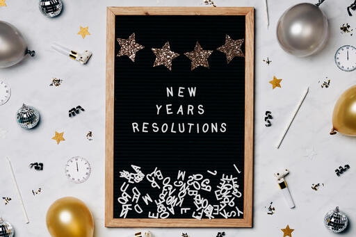 New Years Resolutions Letter Board with New Year's Party Items
