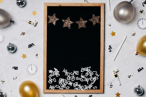 Blank Letter Board with New Year's Party Items