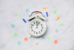 Clock Striking Midnight with Confetti  image 2
