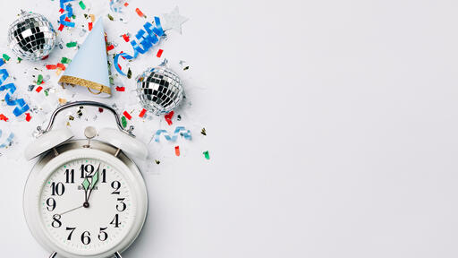 Clock Striking Midnight with Confetti