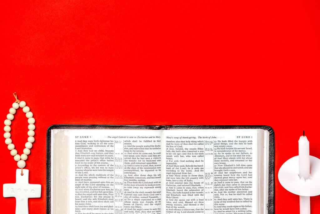 Open Bible with a Cross Christmas Ornament and Candle large preview