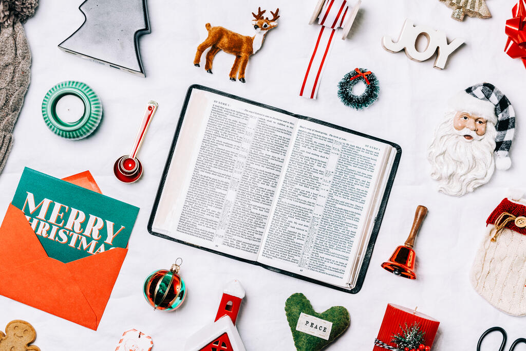 Open Bible with Commercial Christmas Items large preview