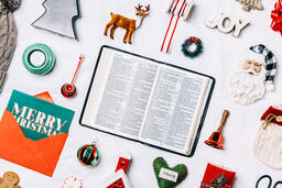 Open Bible with Commercial Christmas Items  image 1